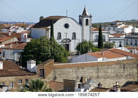 An outstanding white church at the heart of an old Portuguese village.