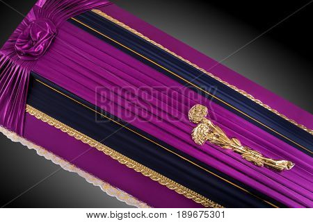 closed purple coffin covered with elegant cloth isolated on gray background. coffin close-up with gold flowers on royal background. Ritual objects for burial. Surrender body dust of the earth. Christian funeral ritual