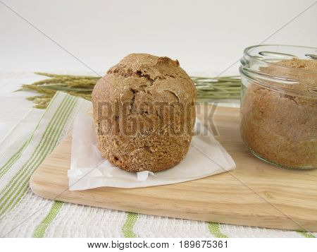 Homemade spelt bread baked in jar on wooden board