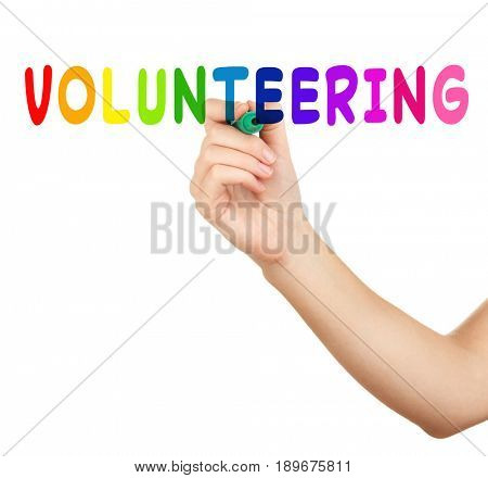 Woman writing word VOLUNTEERING against white background. Concept of support and help