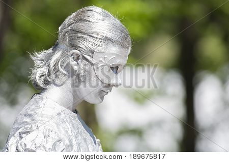 Saint Petersburg, Russia - June 4, 2017: VII international festival of street theatres `Elagin Park`. An animated statue of a man in profile