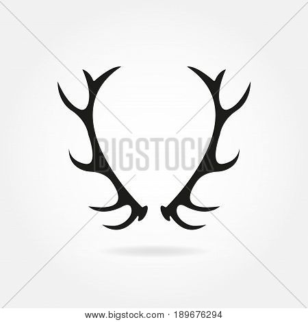 Deer antlers. Horns icon. Black silhouette of antlers in retro style. Vector illustration.
