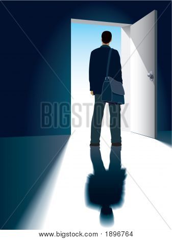 A businessman is standing in front of an open door poster