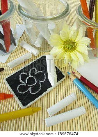 Colored pencils, wax crayons and chalk sticks for children