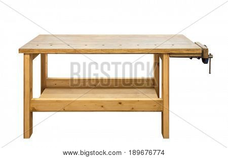 Used wooden workbench with vise. Woodworking workshop table isolated on white background.
