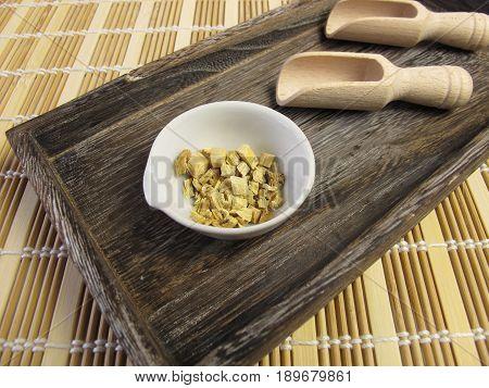 Liquorice root, Liquiritiae radix, in wooden tray