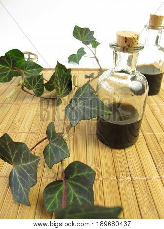 Cough mixture with ivy in medicinal bottle