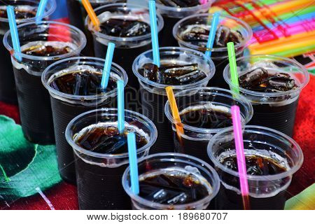 Ice black coffee in transparent plastic cup.