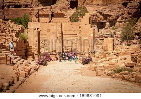 PETRA, JORDAN. May 1, 2014. The arched Roman gate of the ancient Nabataean city of Petra. It's considered one of the modern wonders of the world, a tourist must see. Petra stock image.
