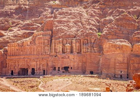 PETRA, JORDAN. May 1, 2014. The Burial complex in Petra that consists of the Palace tomb, Corinthian tomb, silk tomb, urn tomb (left to right). The ancient Nabataean city of Petra.