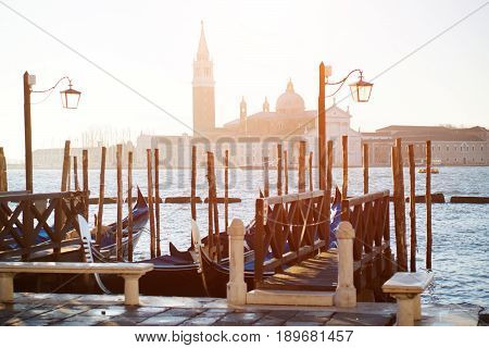 Venice, Italy - scenic view of gondolas and grand canal, on background Saint Mark square