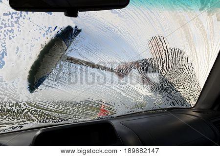 Washing Windshield with Brush