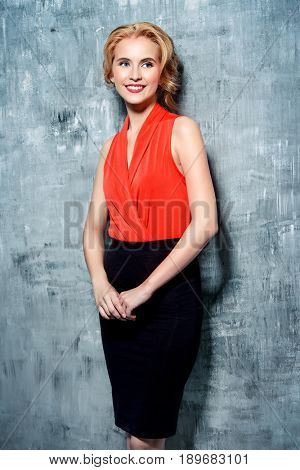 Portrait of a beautiful young business woman smiling at camera. Fashion, business style.