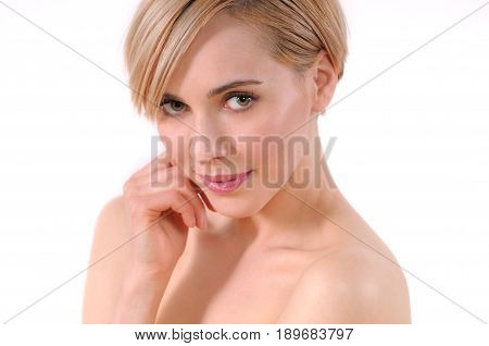 Beautiful spa woman touching her Face. Perfect fresh skin closeup. Isolated on white background. Pure beauty model. Skin care concept. Close up portrait