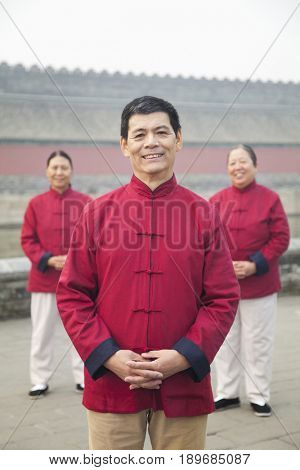 Older Chinese man smiling in park