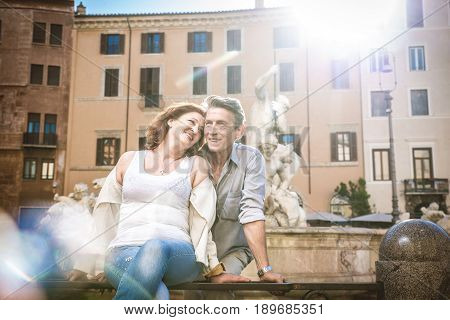 Senior couple at Navona square Rome - Happy tourists visiting italian famous landmarks