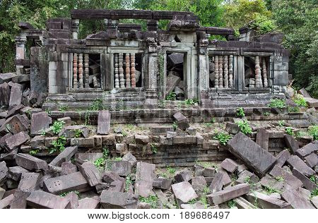 Ruins of ancient Beng Mealea Temple over jungle in Cambodia. Beng Mealea (early 12th century) is a temple located 40 km east of the main group of temples at Angkor, its name means
