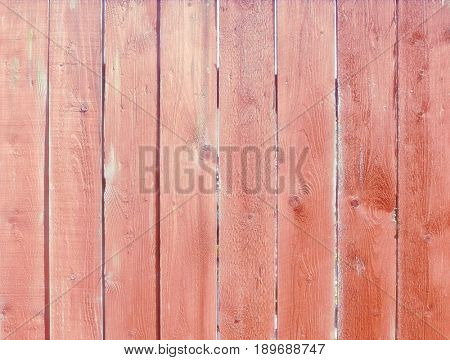 Closeup of pink wooden plank fence