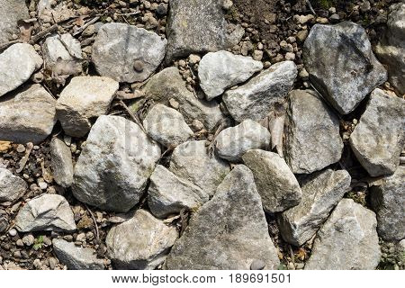View on a Stony Ground. Massive Stones. Fallen Rocks. Broken Rocks on the Ground.