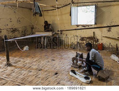 Men In Traditional Dorze Weaving House. Hayzo Village. Dorze. Ethiopia.