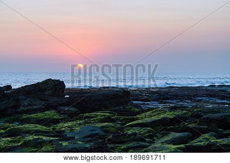 Sunset and sea at tanah lot viewpoint in bali indonesia
