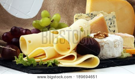 Cheese Platter With Different Cheese, Fig, Salad And Grapes