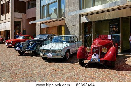 Saint Moritz Switzerland AUG 20 2010: View on navy and red color classic old fashion style classical Alfa Romeo cars at street exhibition. Italian classic cars. Luxury Swiss holidays tours