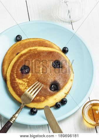 close up of rustic golden blueberry pancake