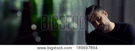 Sad Man And Glass Bottles