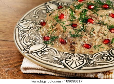 Ethnic regional cuisine of Georgia - prepared from chicken meat and walnuts with pomegranate