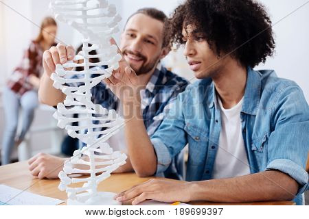 Fascinating observations. Two motivated enthusiastic handsome guys getting acquainted with the structure of human DNA while studying genetics and attending classes at the university