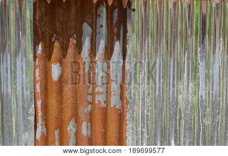 Old brown and gray zinc. The fence in the country house has long been used as a rusty. can be used as background.