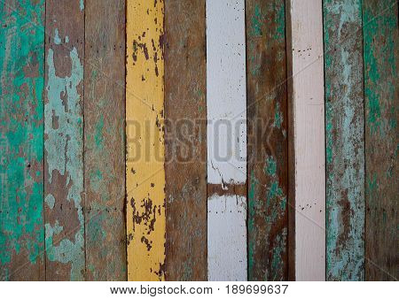 Old vintage wooden background with many colors. Colorful striped wood lumber wall.