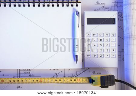 Contractor concept. Construction blueprints with tools, top view.