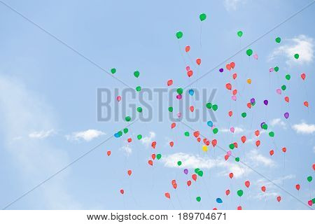 Colorful baloons in the blue sky. Baloons flying high. Background.