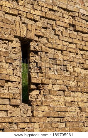 Gun loophole in the brick wall of the fortification of the nineteenth century The Kiev Fortress