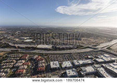 Oxnard, California, USA - May 27, 2017:  Aerial view of homes, buildings and shopping centers along the Ventura 101 Freeway.