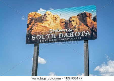 RUNNING WATER  SD, USA - MAY 28, 2017: Welcome to South Dakota road sign against blue sky. Great faces, great places.