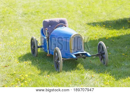 STOCKHOLM SWEDEN - MAY 21 2017: Beautiful blue soapbox car parked on the grass in the race Gardesloppet at Djurgarden Stockholm Sweden. May 21 2017