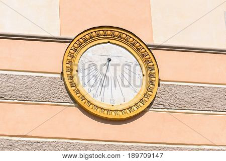 Round decorative vintage sundial on the wall