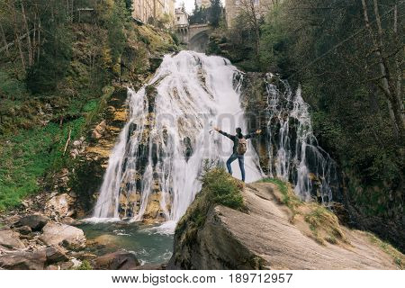 Austria. Bad Gastein. Girl At The Waterfall In The Alpine Mountains