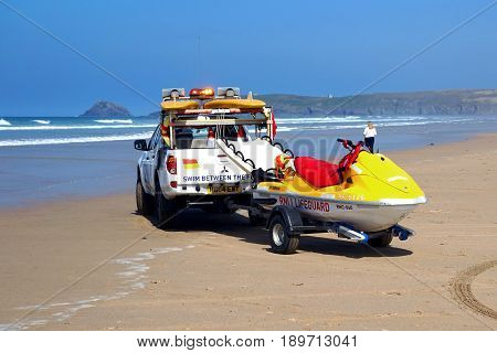 Newquay, Cornwall, Uk - April 7 2017: Rnli Lifeguard Truck And Jetski On A Cornish Surfing Beach At