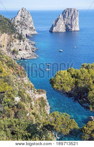 amazing Faraglioni cliffs panorama with the Tyrrhenian sea in background, Capri island, Campania region, Italy