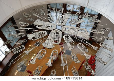 LONDON, ENGLAND - May 24,2017: flattened brass music instruments, sculpture