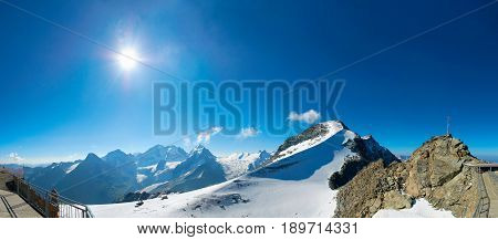 Panoramic view on Alpine mountain funicular station Corvatsch sun summer mountain snow and Corvatsch Peak, Saint Moritz. Swiss Alpine landscape