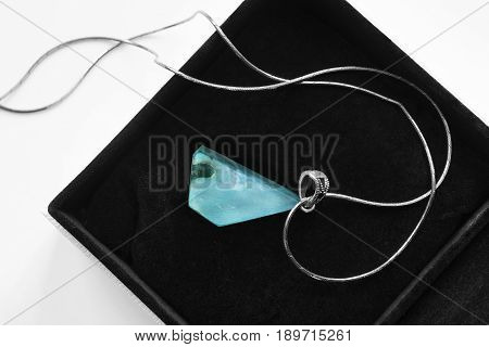 Natural turquoise pendant on silver chain in black jewel box