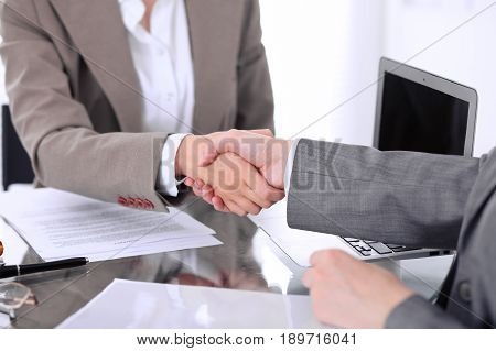Business handshake. Two women lawyers are shaking hands after meeting or negotiation
