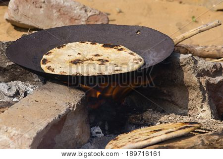 Indian chapatti on fire Pushkar India Close up