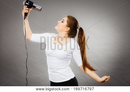 Woman Drying Her Hair Using Hair Dryer