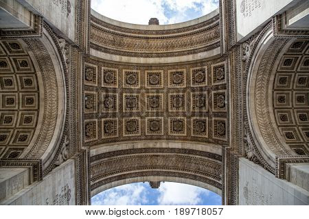 The Arc de Triomphe in Paris as seen from under the arc.